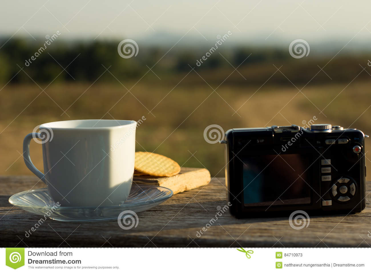 Coffee with snacks meadows as a backdrop, Place the camera with