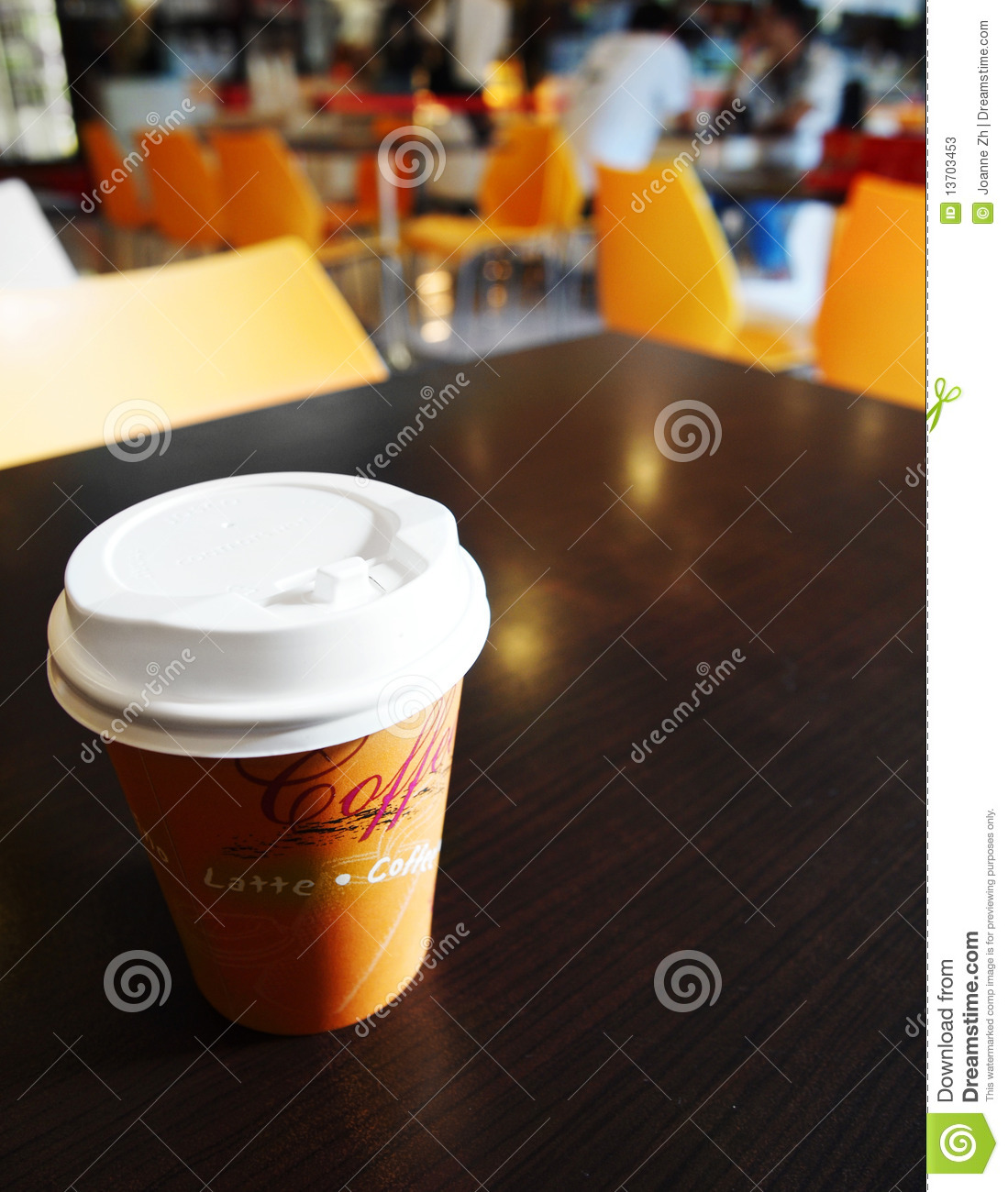 Coffee takeout cup on campus cafe table