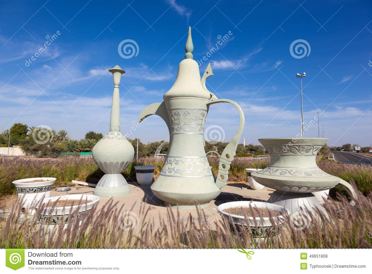 Coffeepot sculpture in a roundabout in al ain stock photo for Al manzool decoration abu dhabi