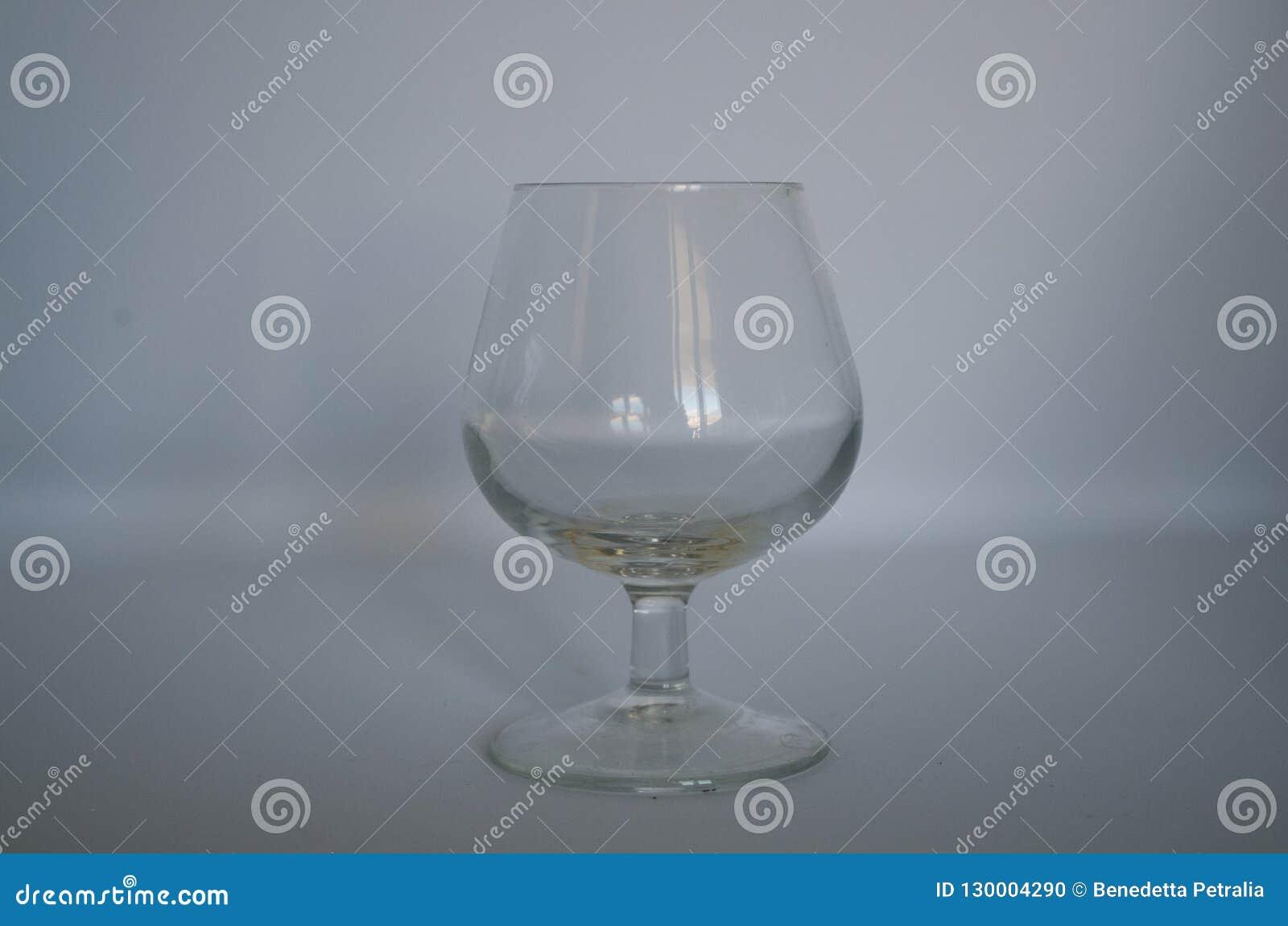 Cognac glass empty on white background