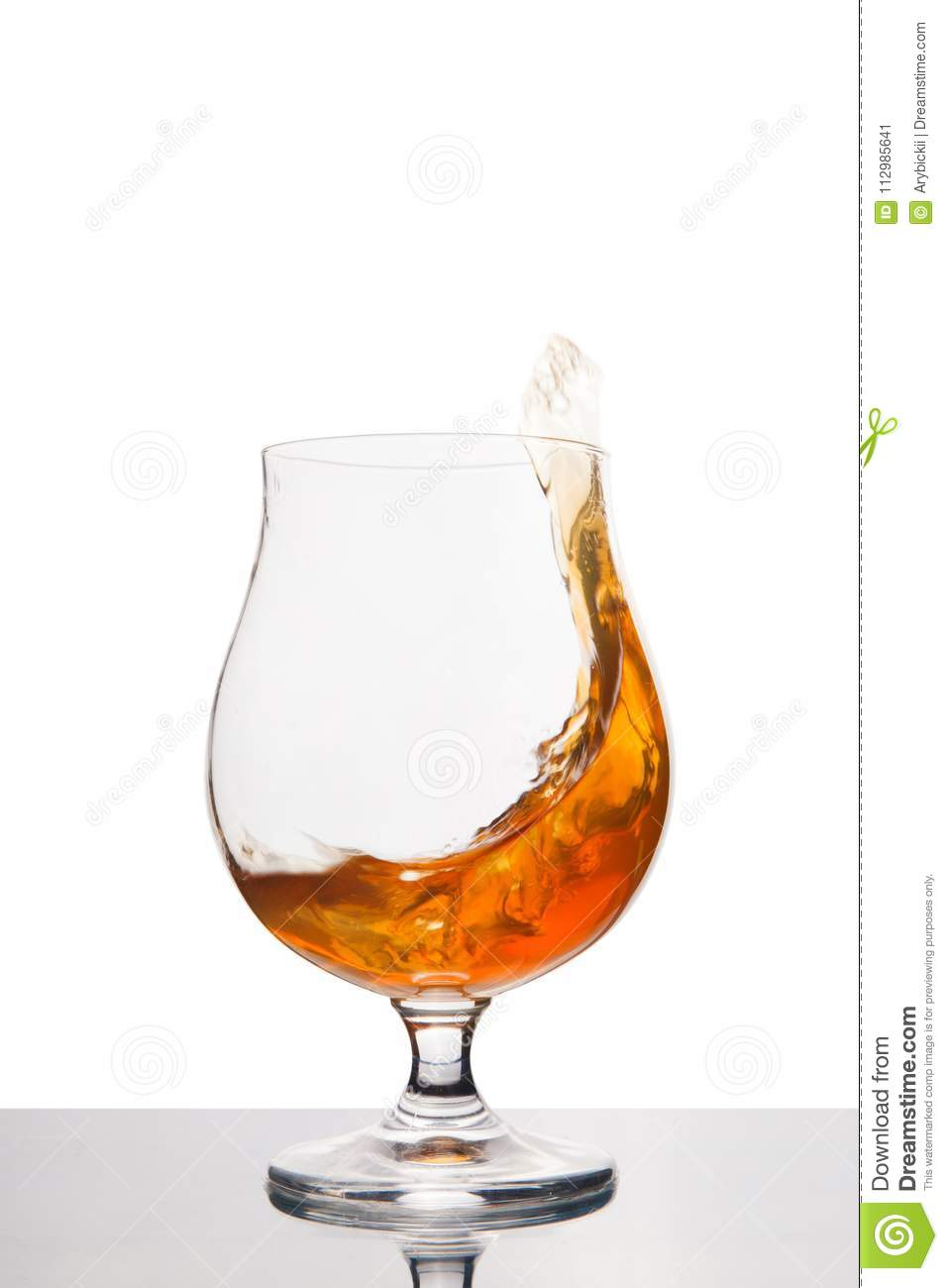 Cognac in wineglass isolated on white