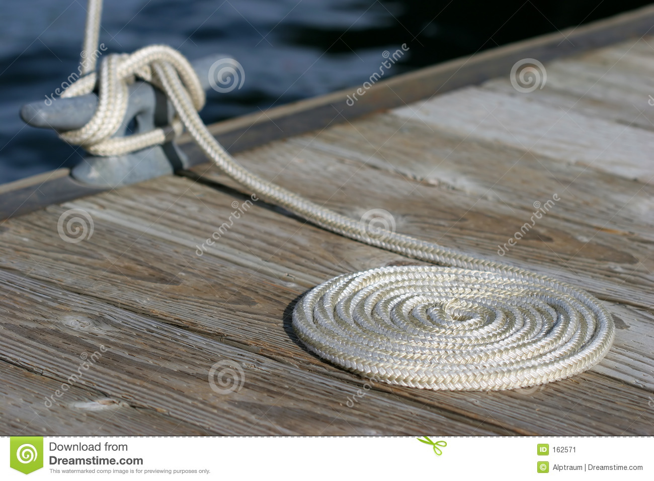 Download Coiled rope and cleat stock image. Image of knot, neat - 162571