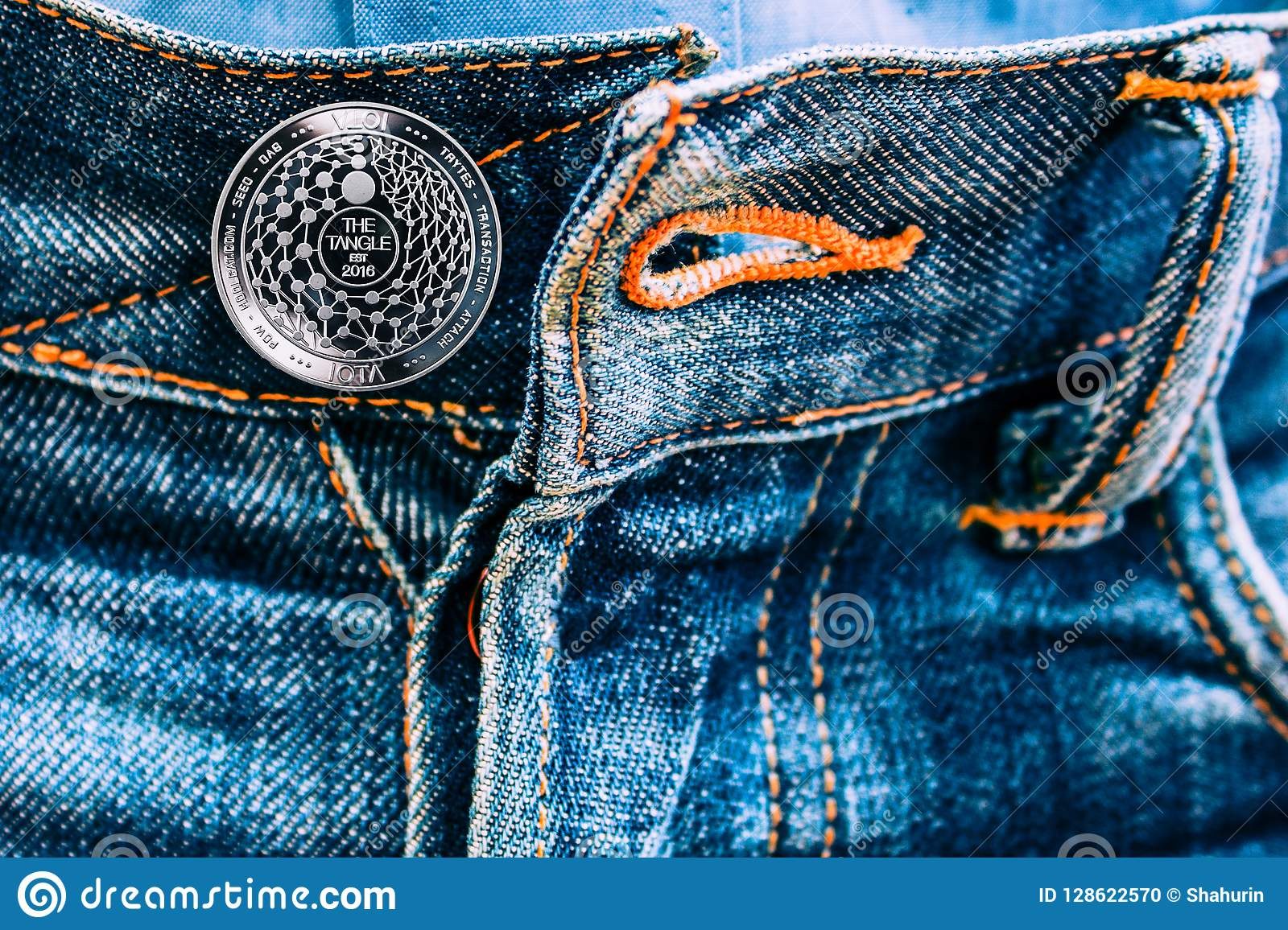 Miota coin instead of buttons on jeans.
