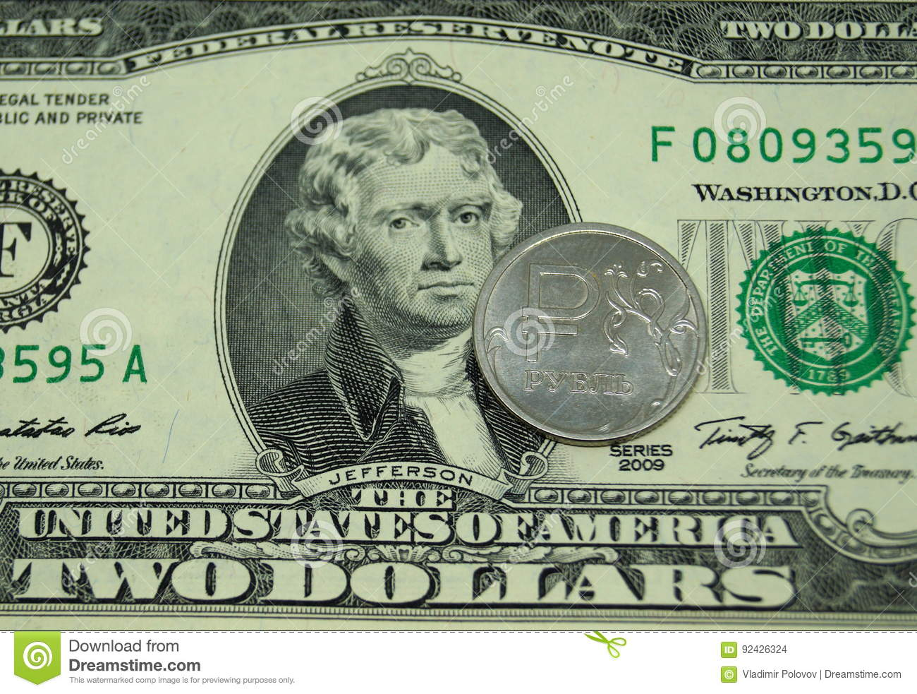 A Coin In One Ruble Lies On A Two-dollar Bill  Stock Photo