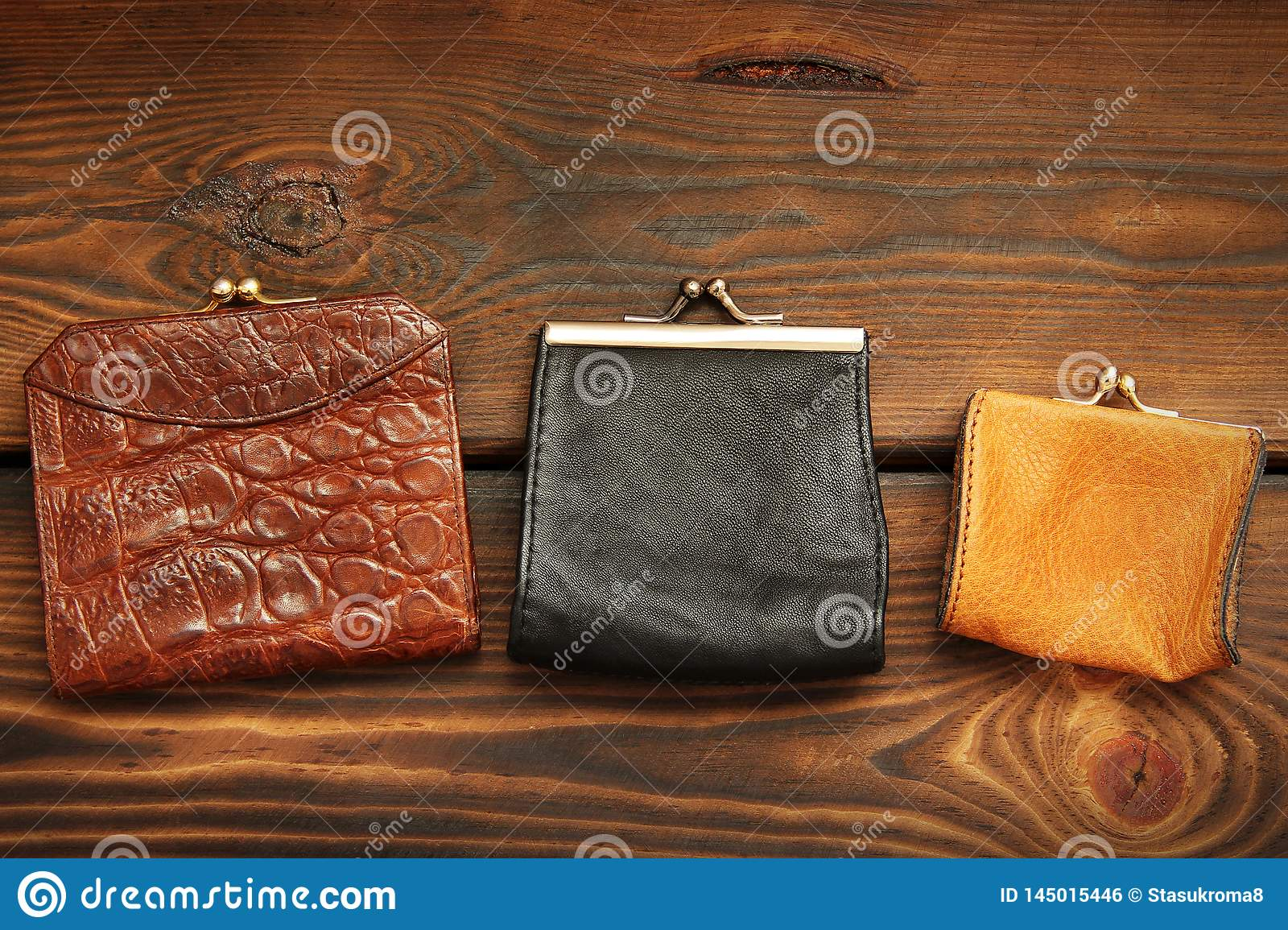 Coin purse on a wooden background