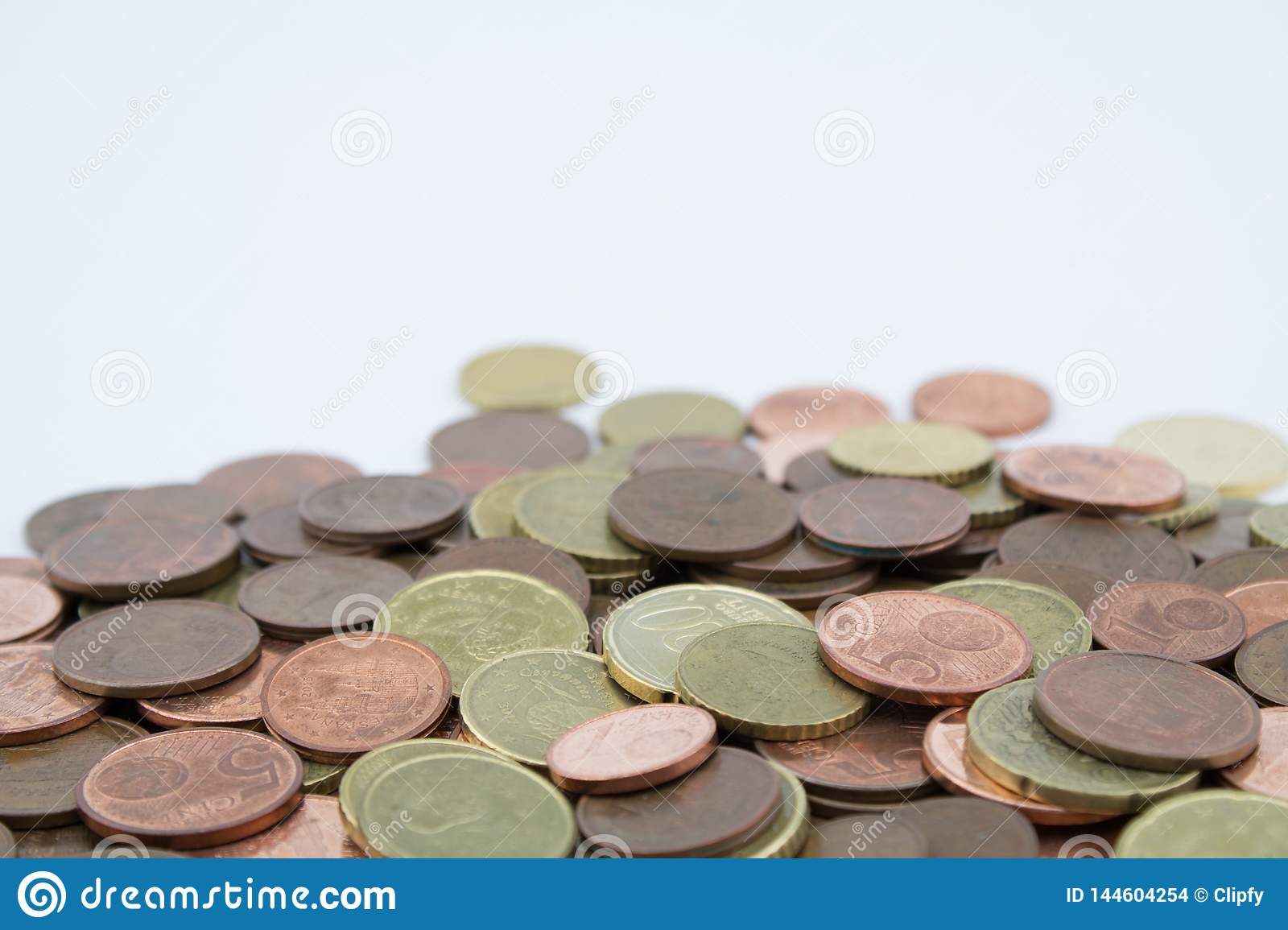 Coins of euro cents of small value on white background