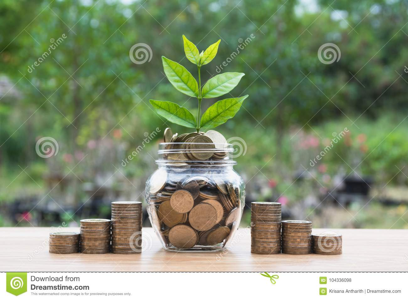Coins in jar with money stack step growing money.