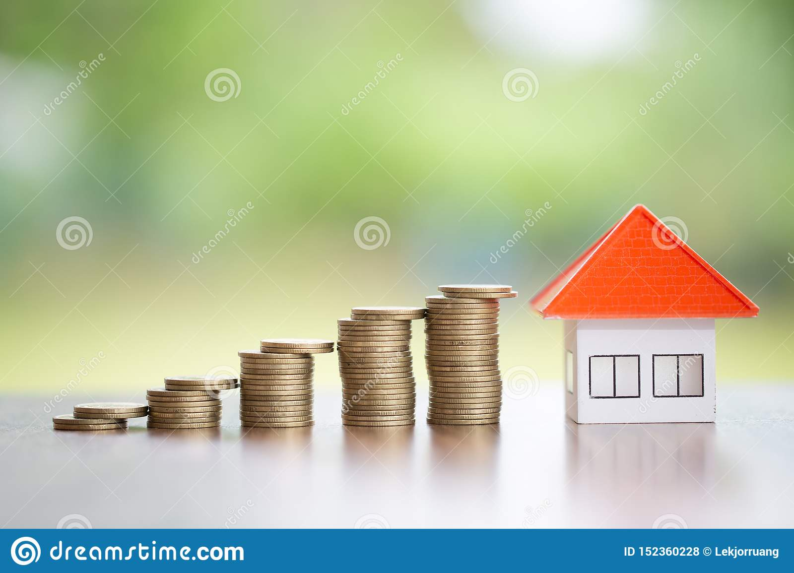 Coins money setting growth up increase to house model for concept investment mortgage finance and home loan business, business,