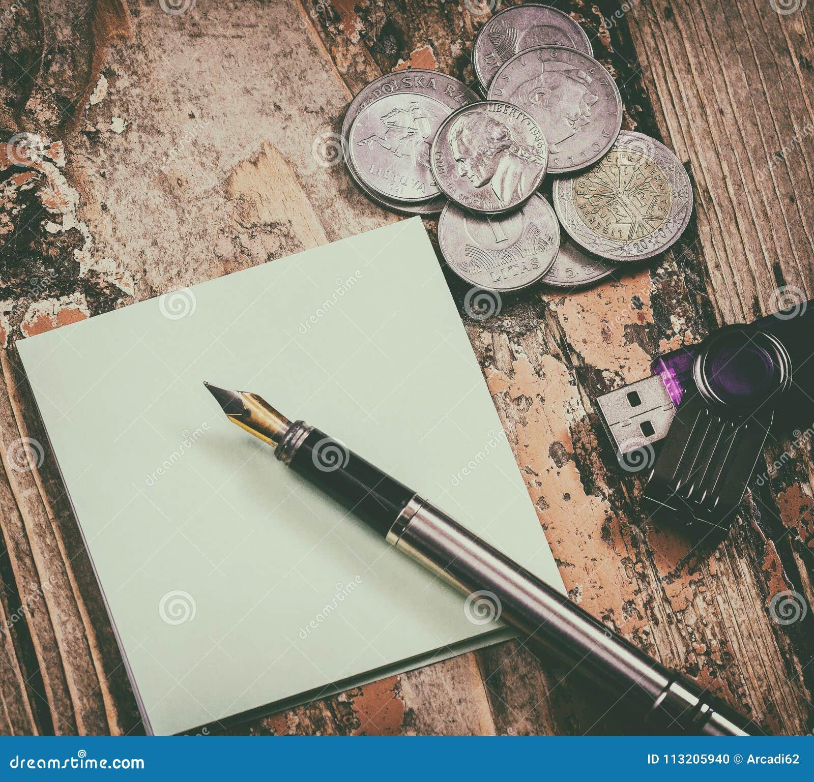 Coins, pen