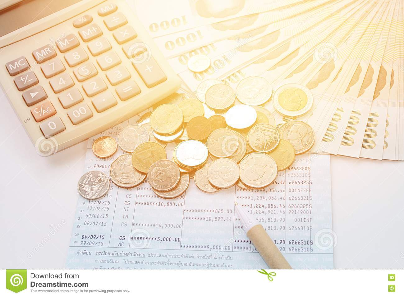 Coins, Thai Money, Pen, Calculator And Savings Account Passbook On White  Background Stock