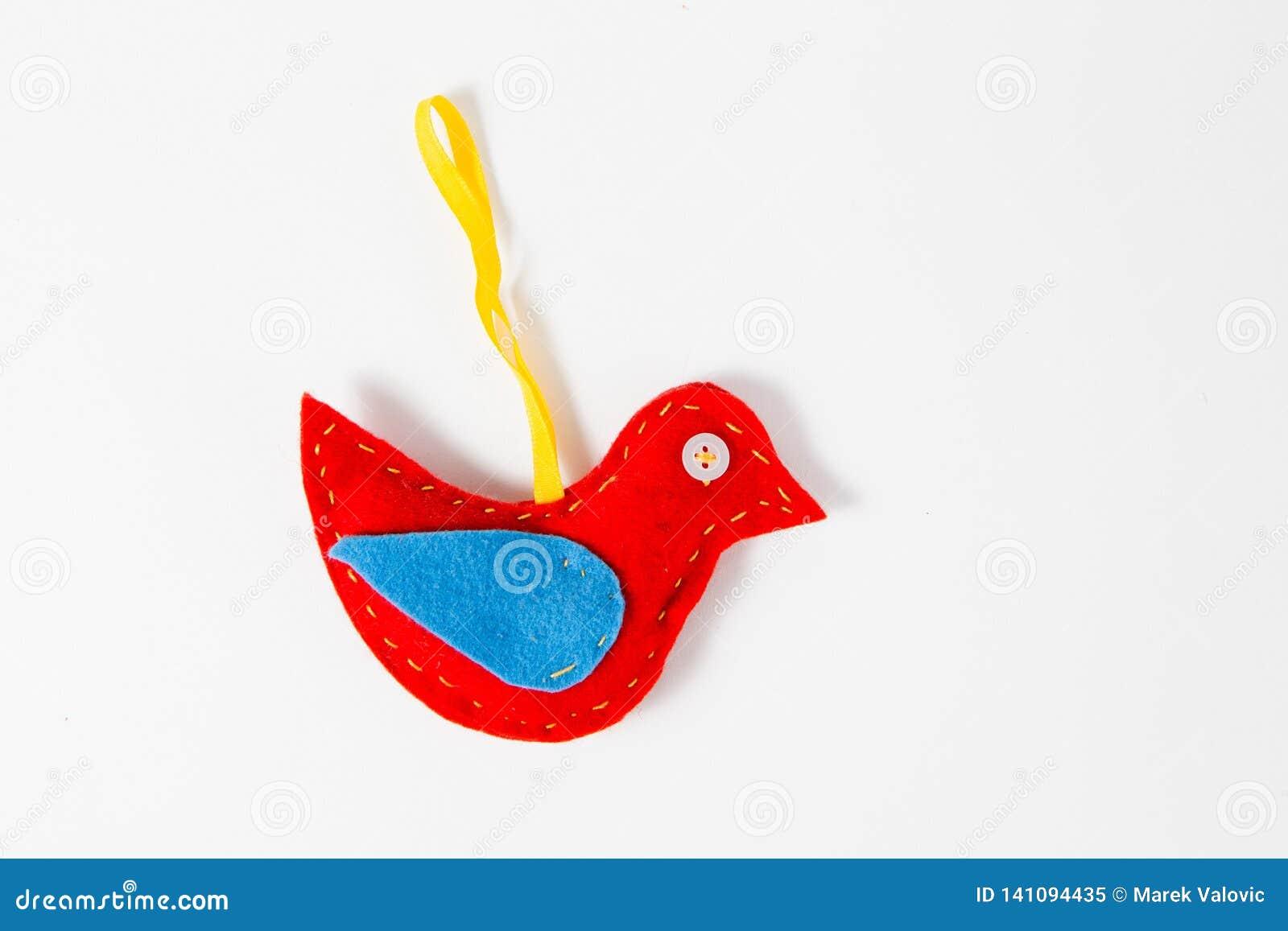Cojín hecho a mano de la aguja formado como pájaro