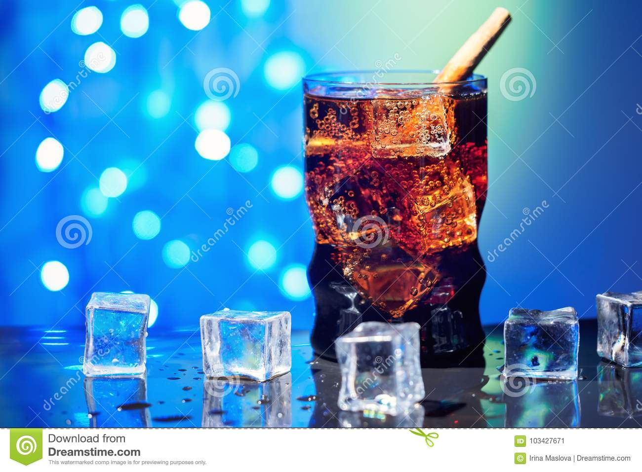 Cola in drinking glass with ice cube sweet sparkling carbonated drink beverage fast food with big calorie