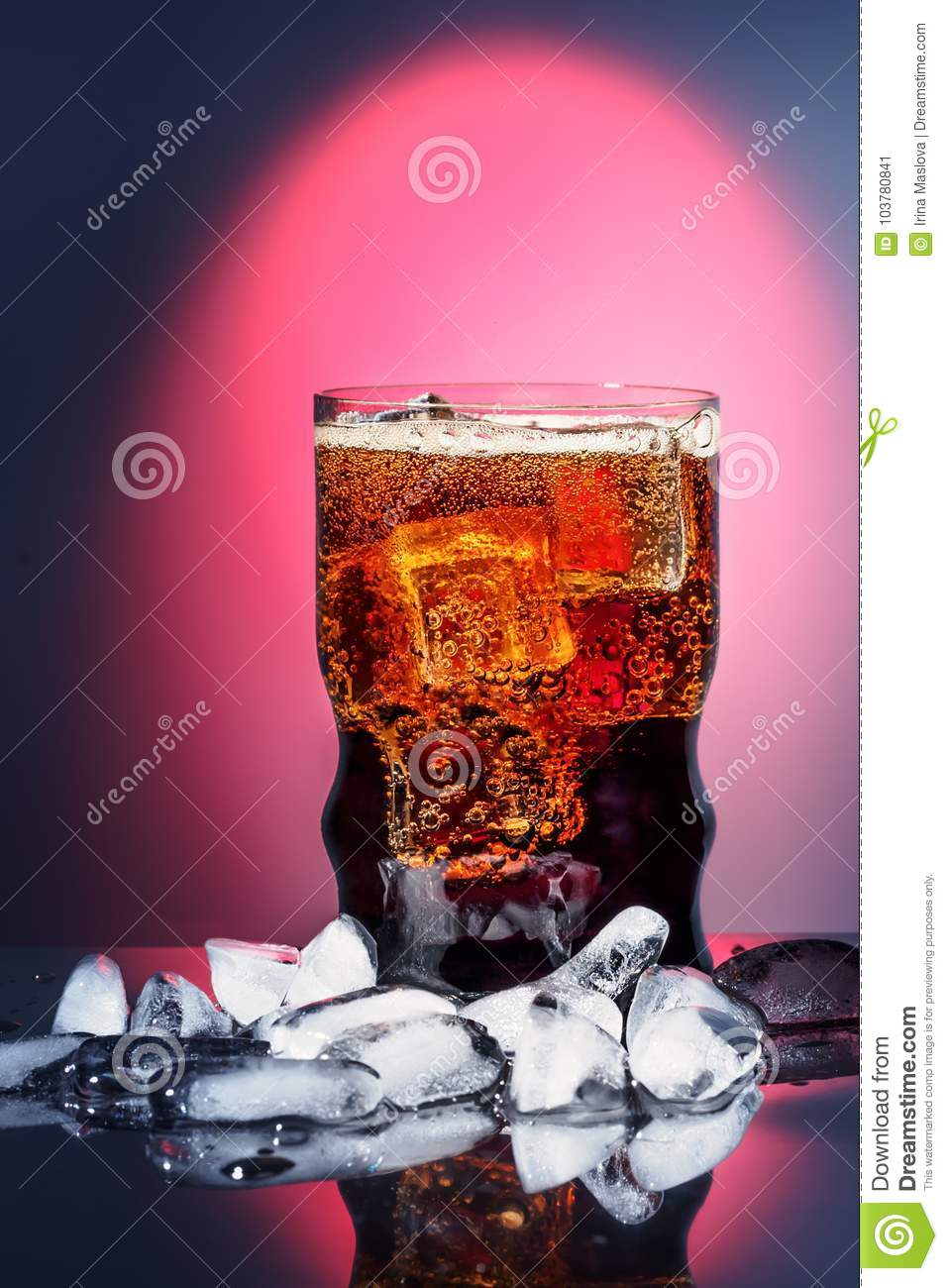 Cola in drinking glass with ice sweet sparkling carbonated drink beverage fast food with big calorie