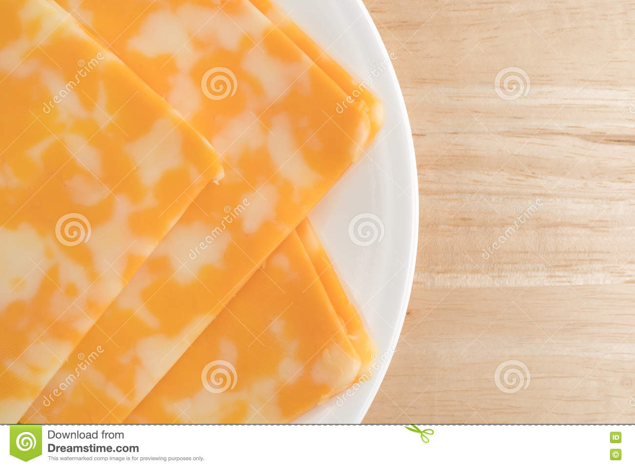 Colby-Jack Cheese Slices On A Plate Atop Table Top Close