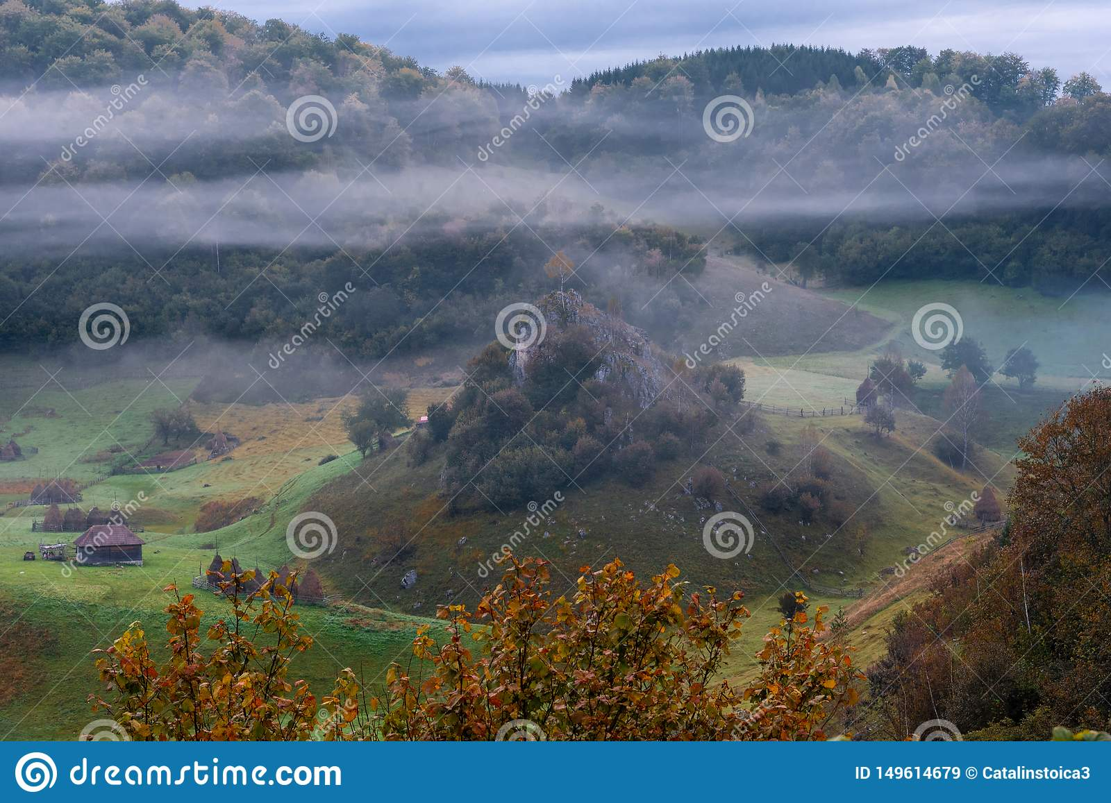 Cold misty morning in stunning remote location, Fundatura Ponorului village, Romania