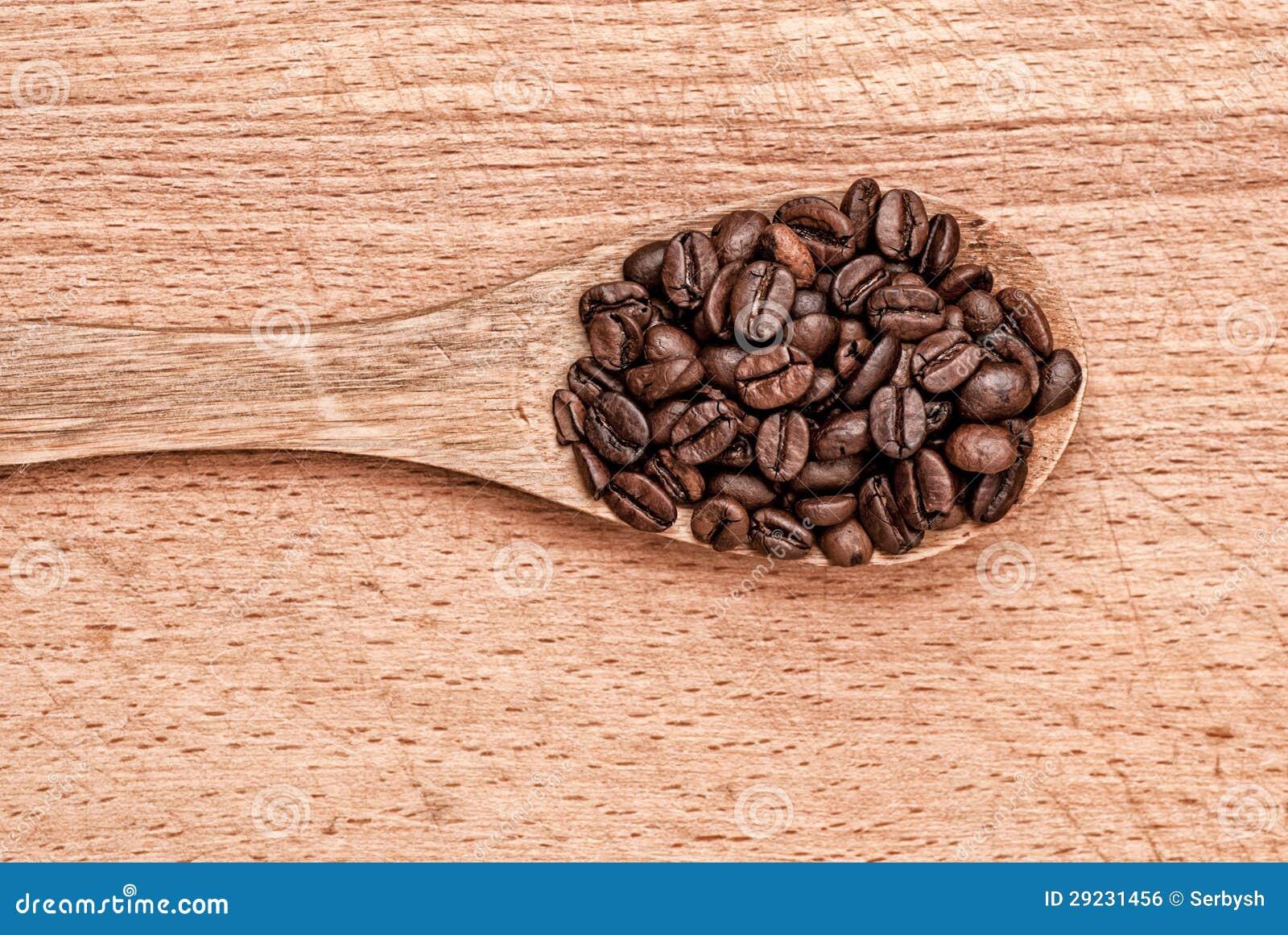 Download Colher Com Feijões De Café Em Uma Tabela De Madeira Foto de Stock - Imagem de colher, restaurante: 29231456