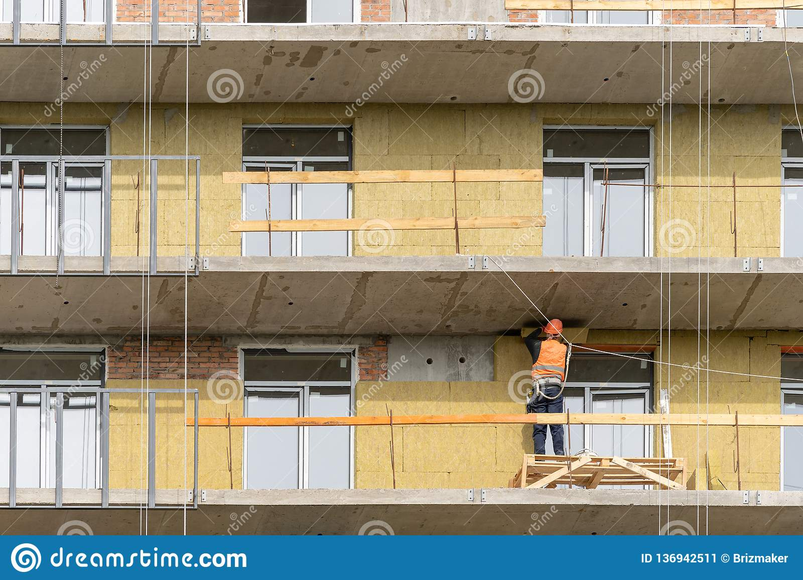 Collar occupation installing insulation panel on wall
