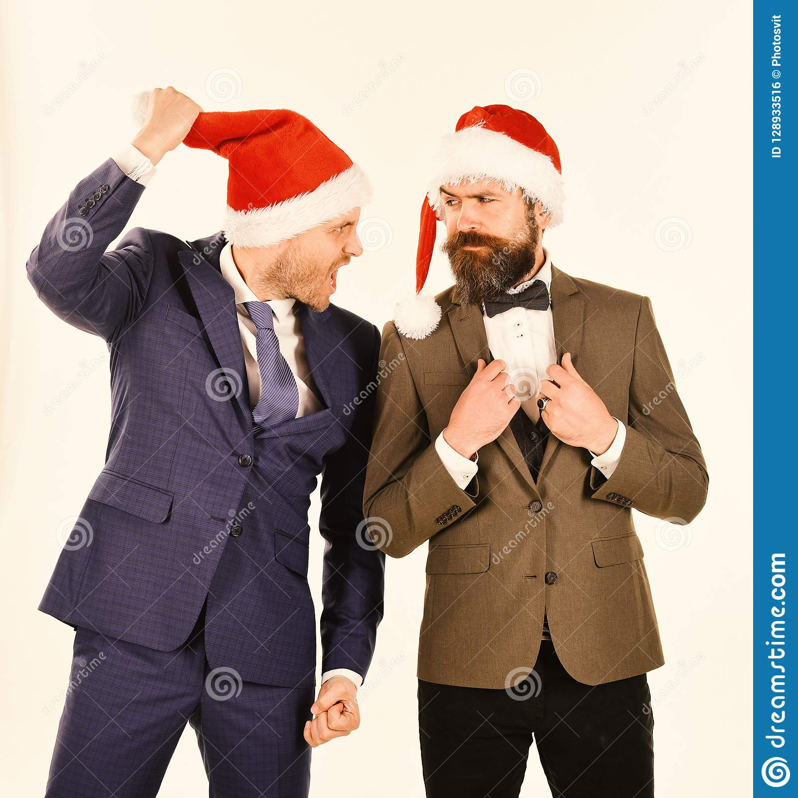 Colleagues with beards argue about business. Christmas celebration