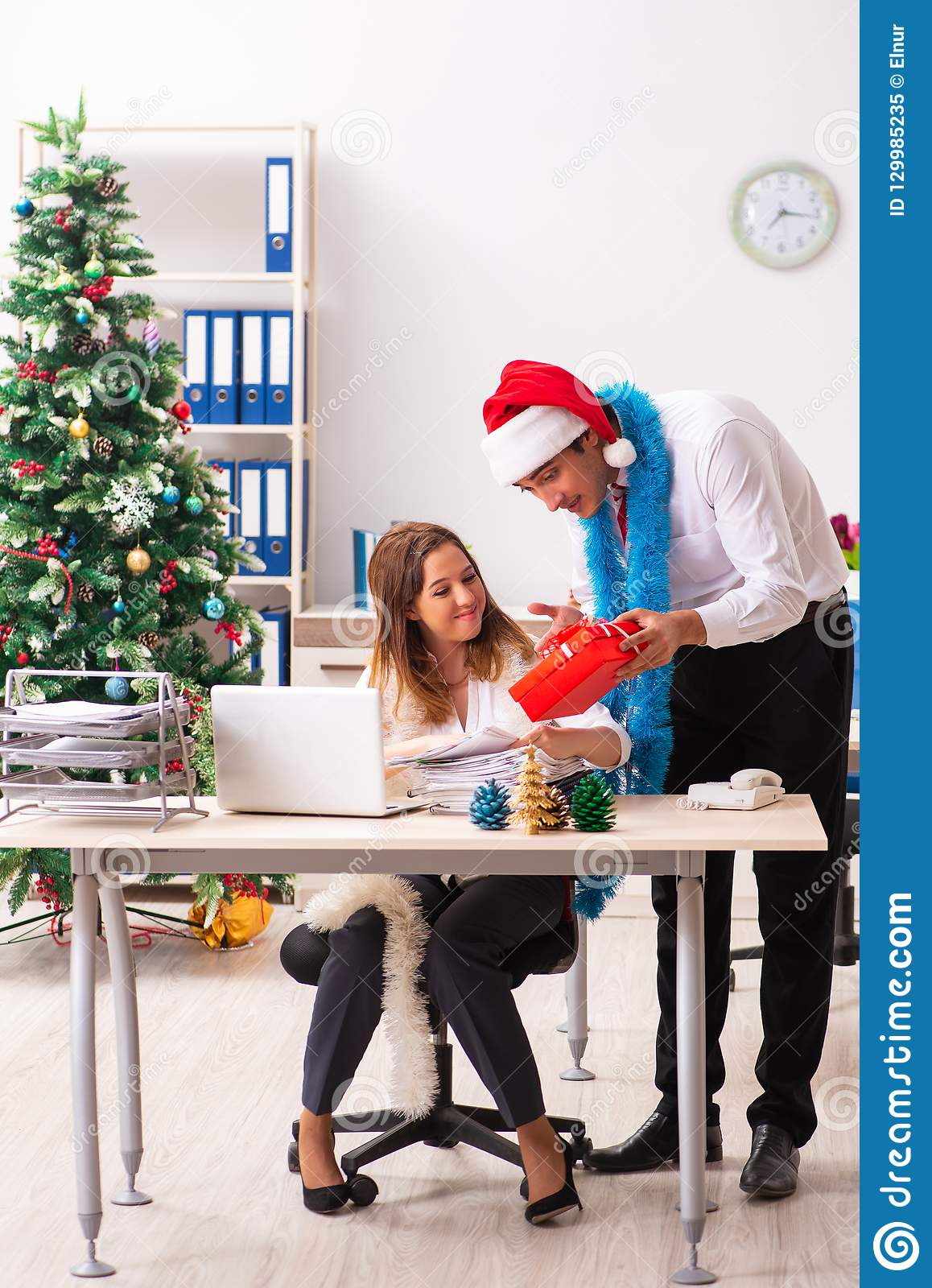 The Colleagues Exchaing Christmas Presents In Office Stock Image ...