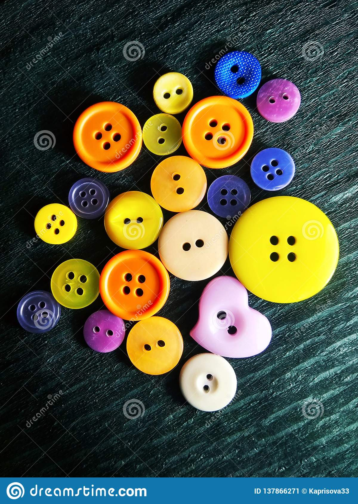 Big and small color buttons on black