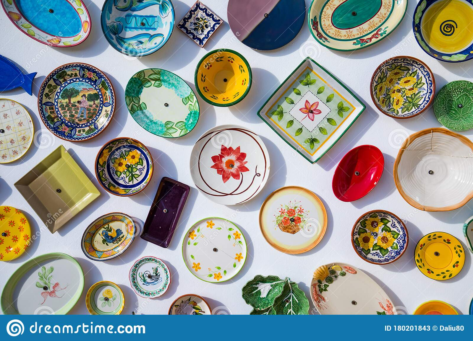 Collection Of Colorful Portuguese Ceramic Pottery, Local Craft Products  From Portugal. Ceramic Plates Display In Portugal. Editorial Stock Photo -  Image of pottery, portugal: 180201843