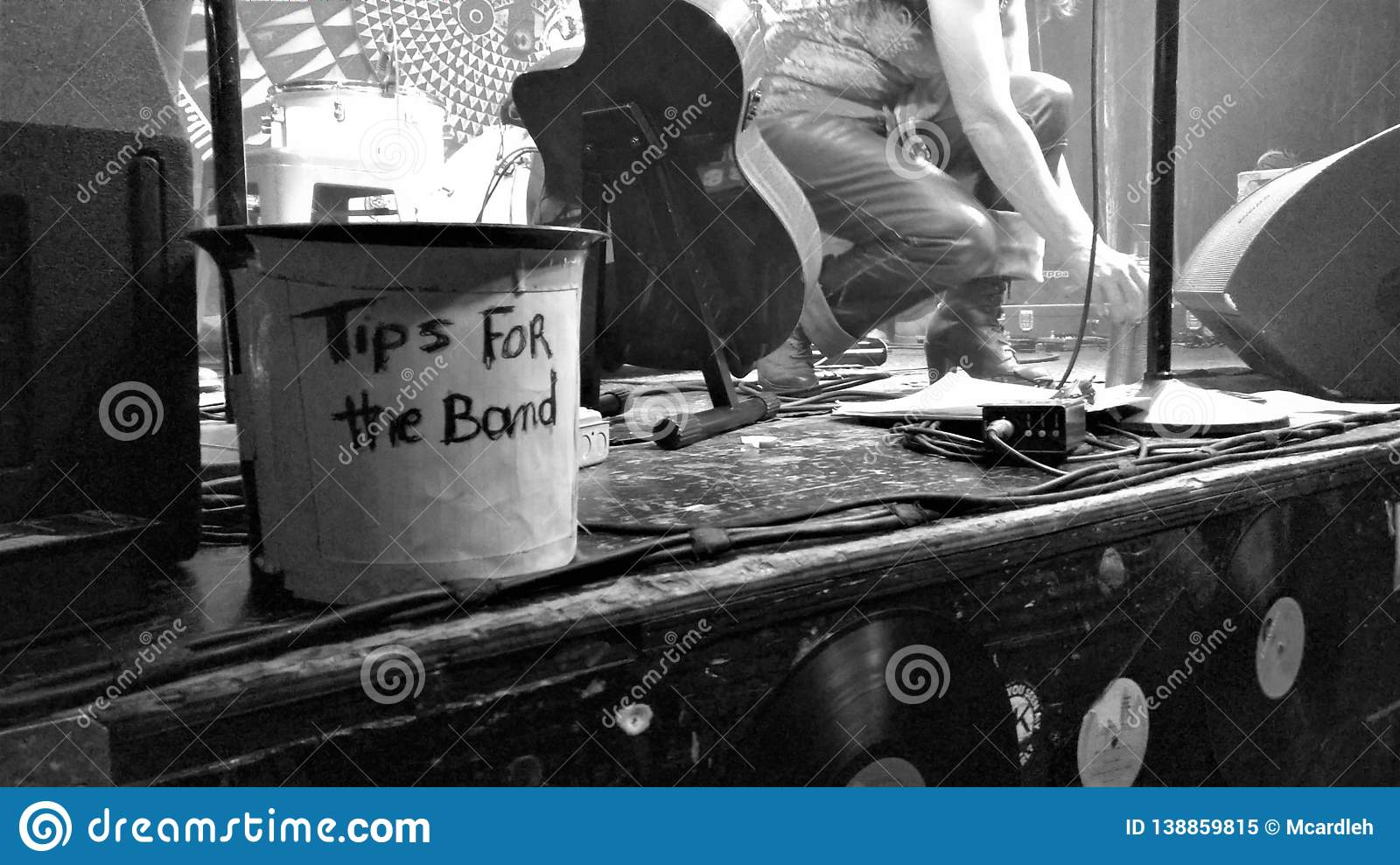 Tips bucket on concert stage