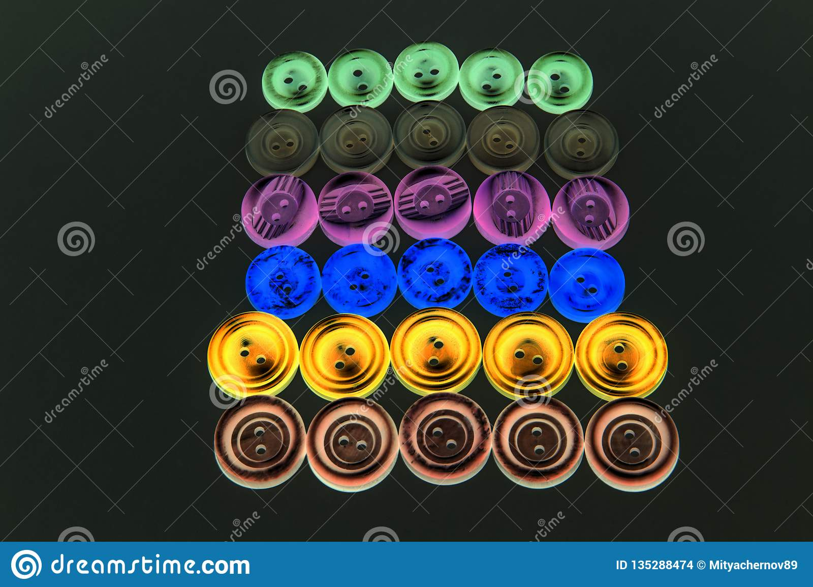 Collection of different buttons for clothes repair. Abstraction.