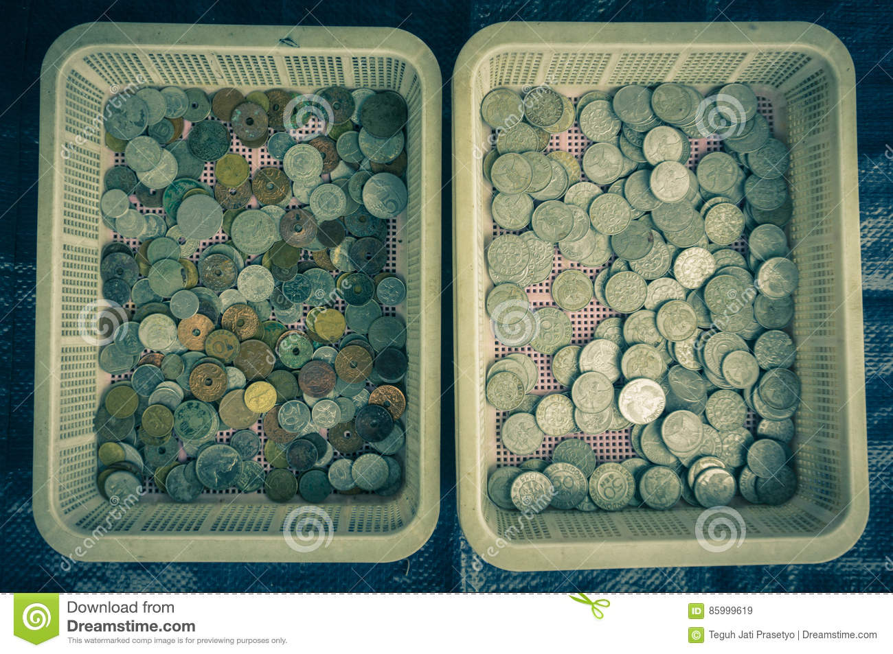 Collection of indonesia`s coins displayed on a plastic basket photo taken in Bogor Indonesia