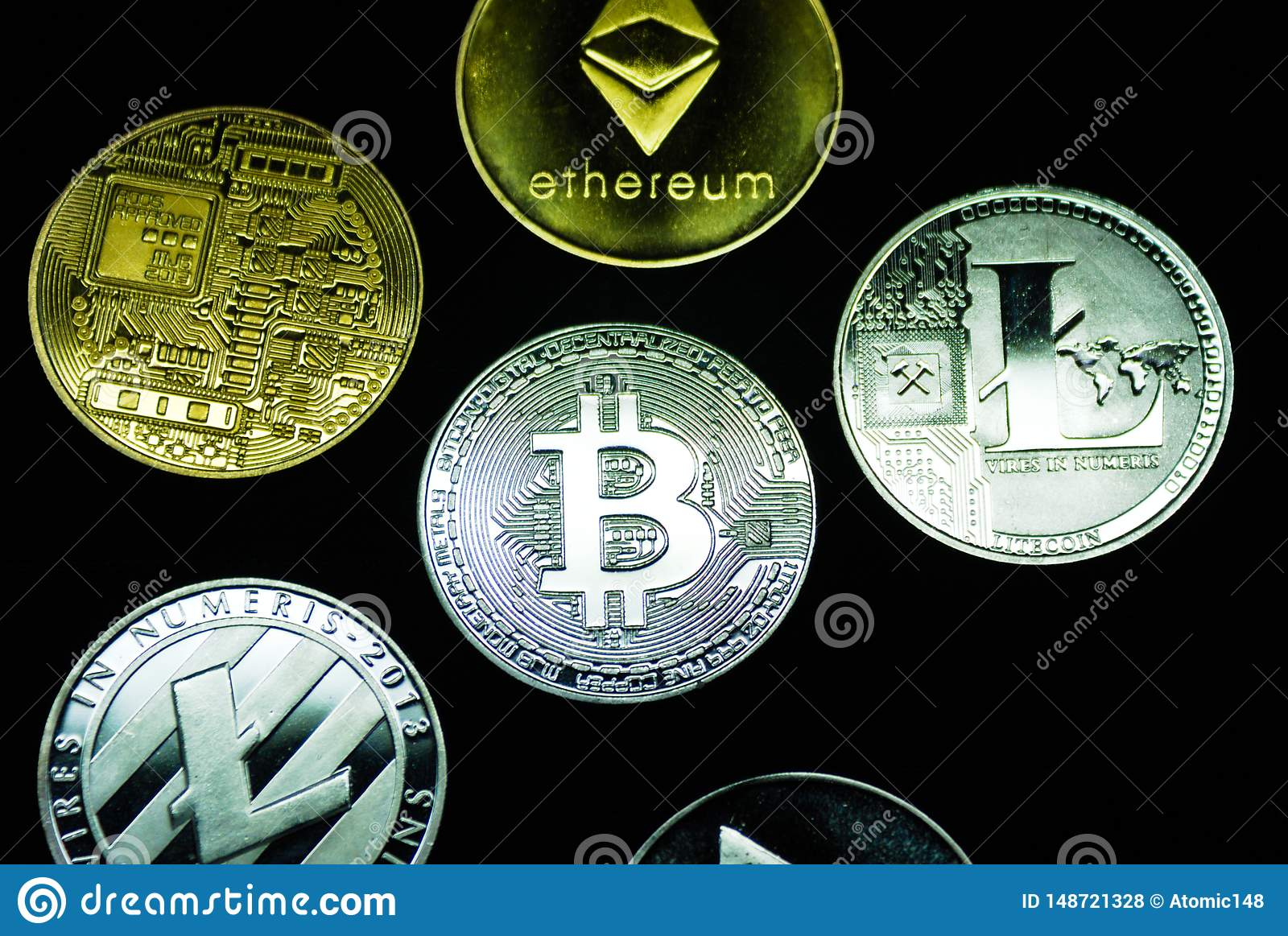 Collection of silver and gold cryptocurrency coins