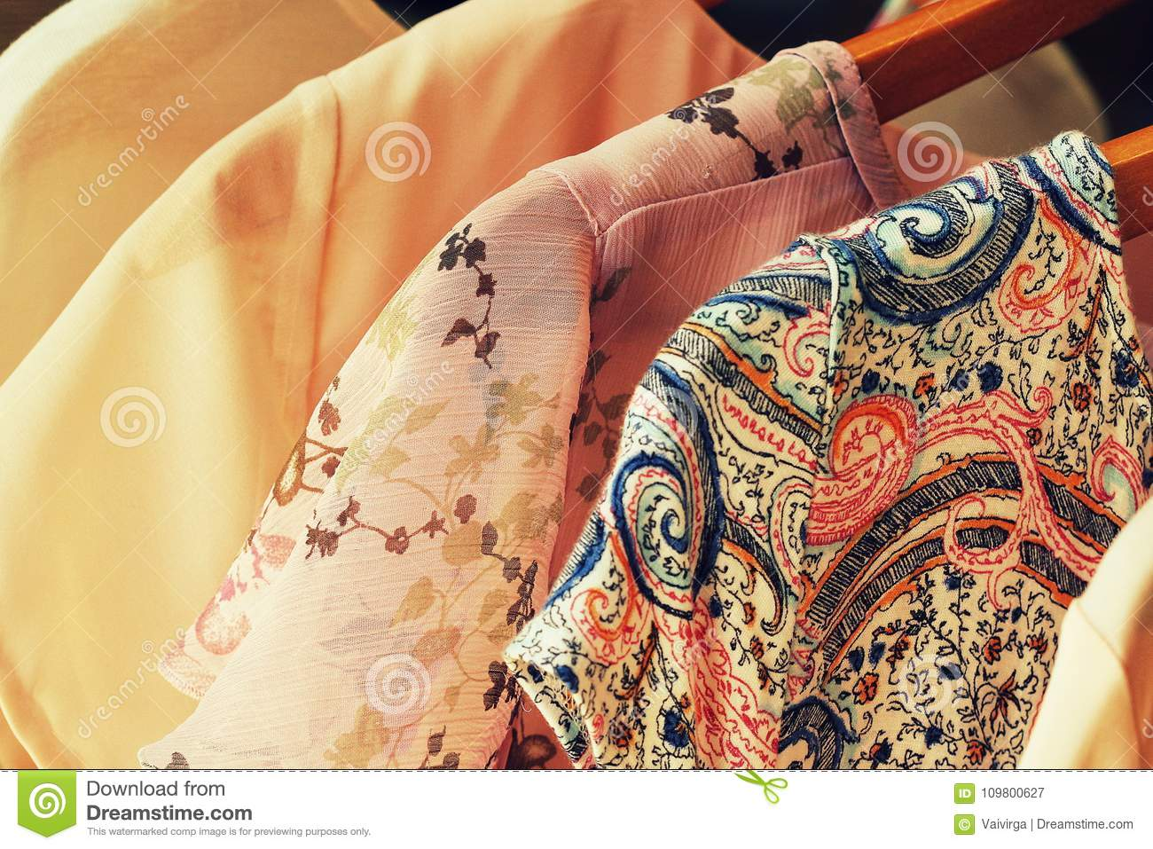 Collection of women`s clothes hanging on rack for sale