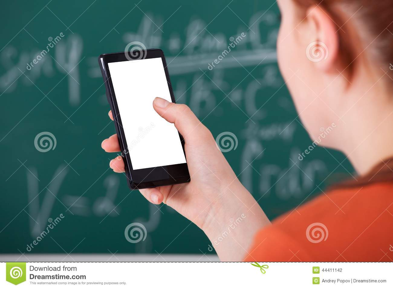 College Student Using Smart Phone In Classroom Stock Photo