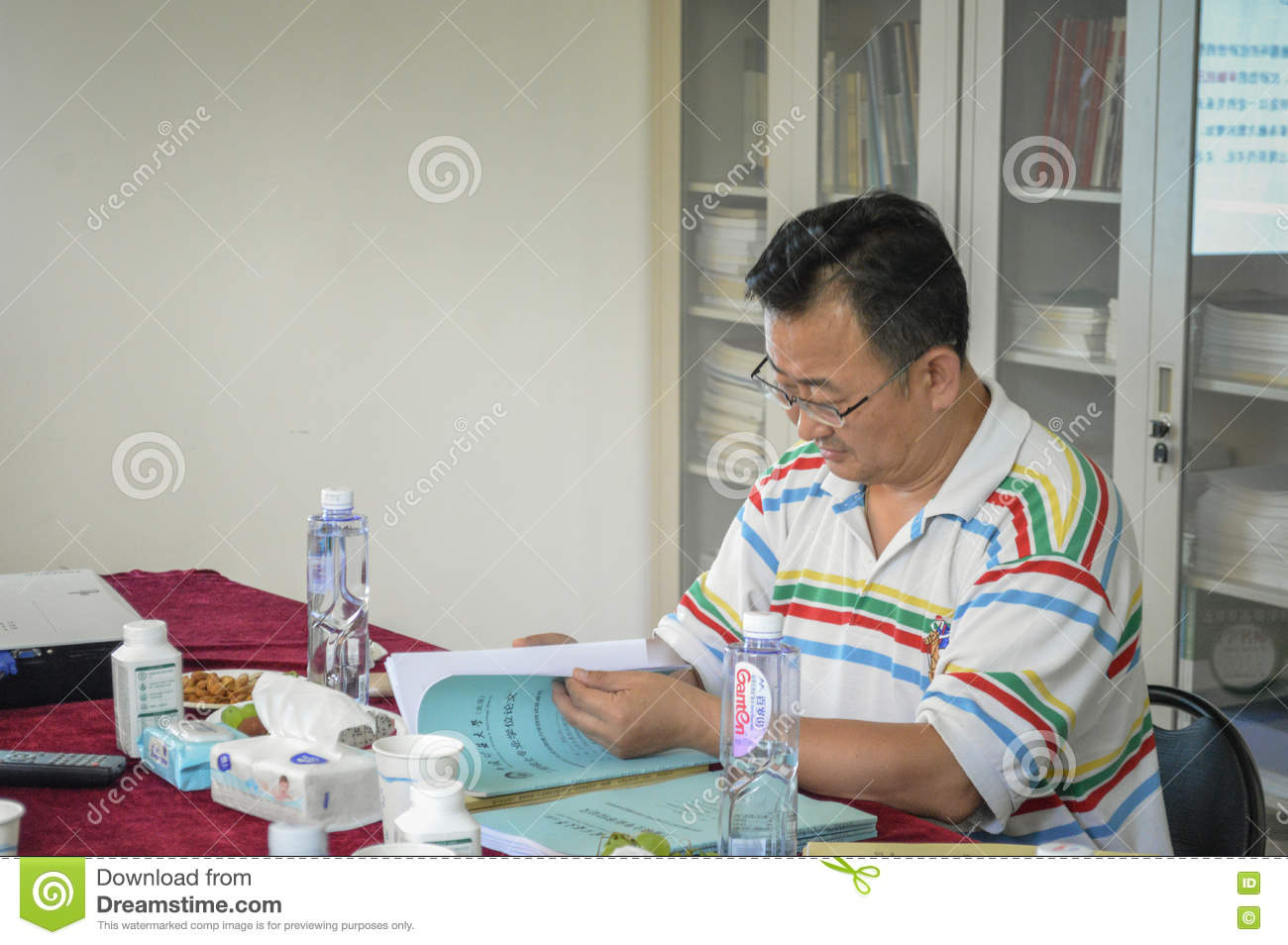 college teacher grading exams editorial photography image of china