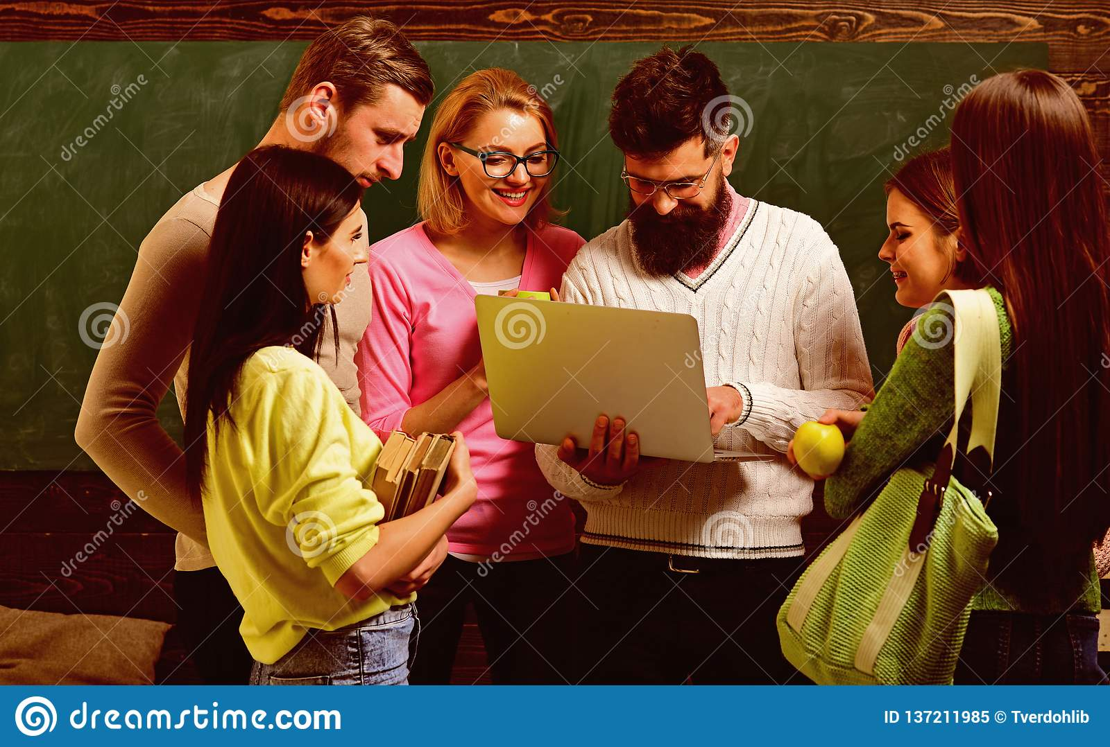 College and university concept. Group of students, groupmates spend time with teacher, lecturer, professor. Students