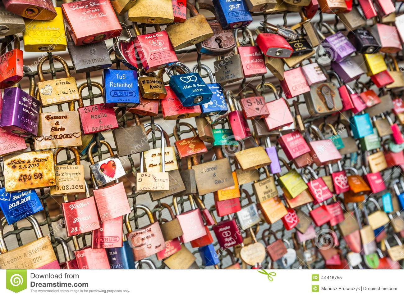 COLOGNE, GERMANY - AUGUST 26, 2014, Thousands of love locks which sweethearts lock to the Hohenzollern Bridge to symbolize their