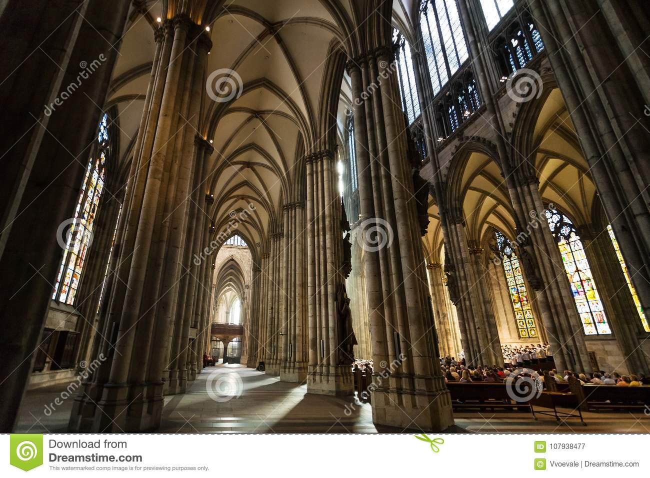 People in church service in Cologne Cathedral