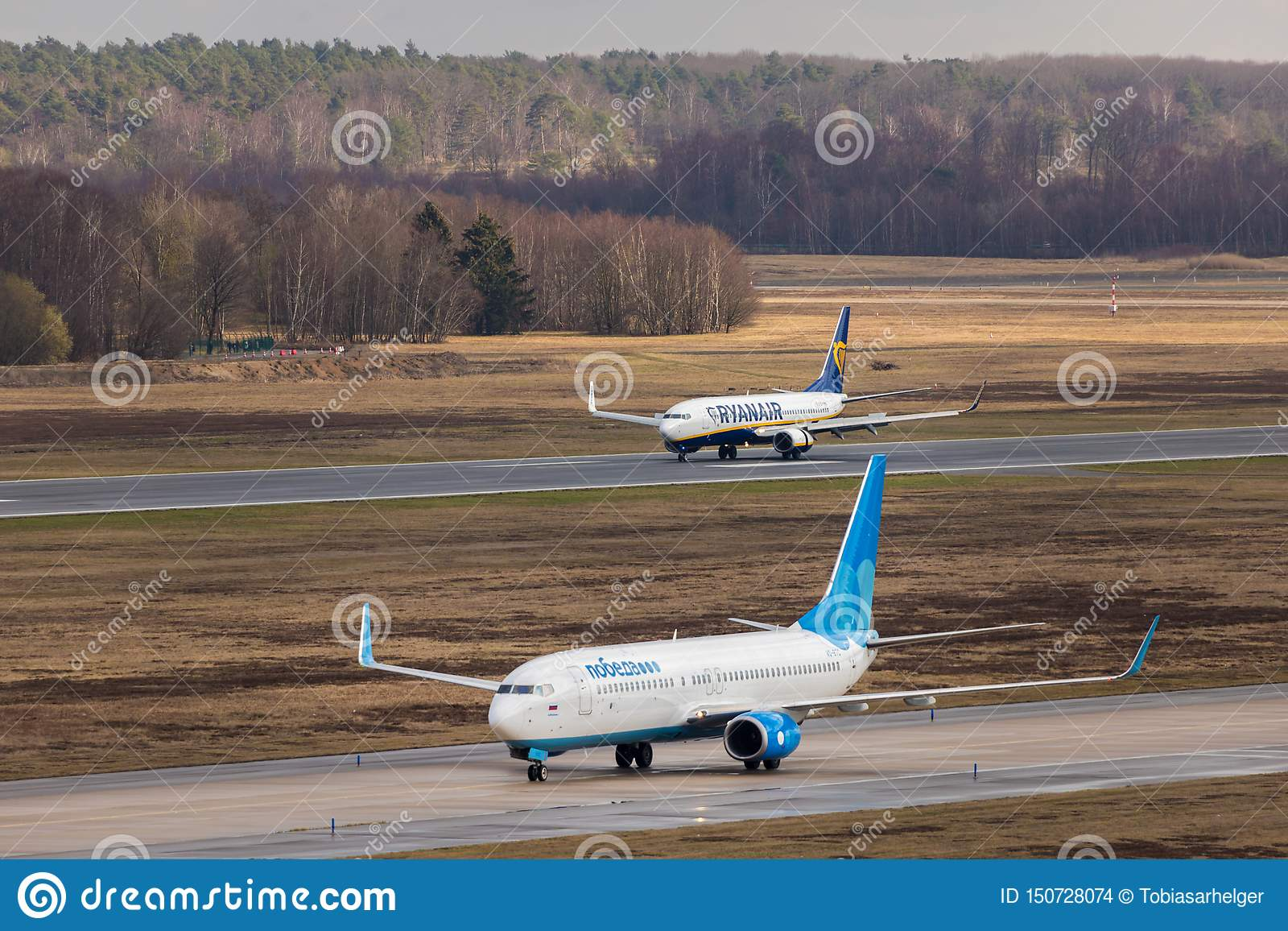 An ryanair and pobeda airplane at cologne bonn airport germany