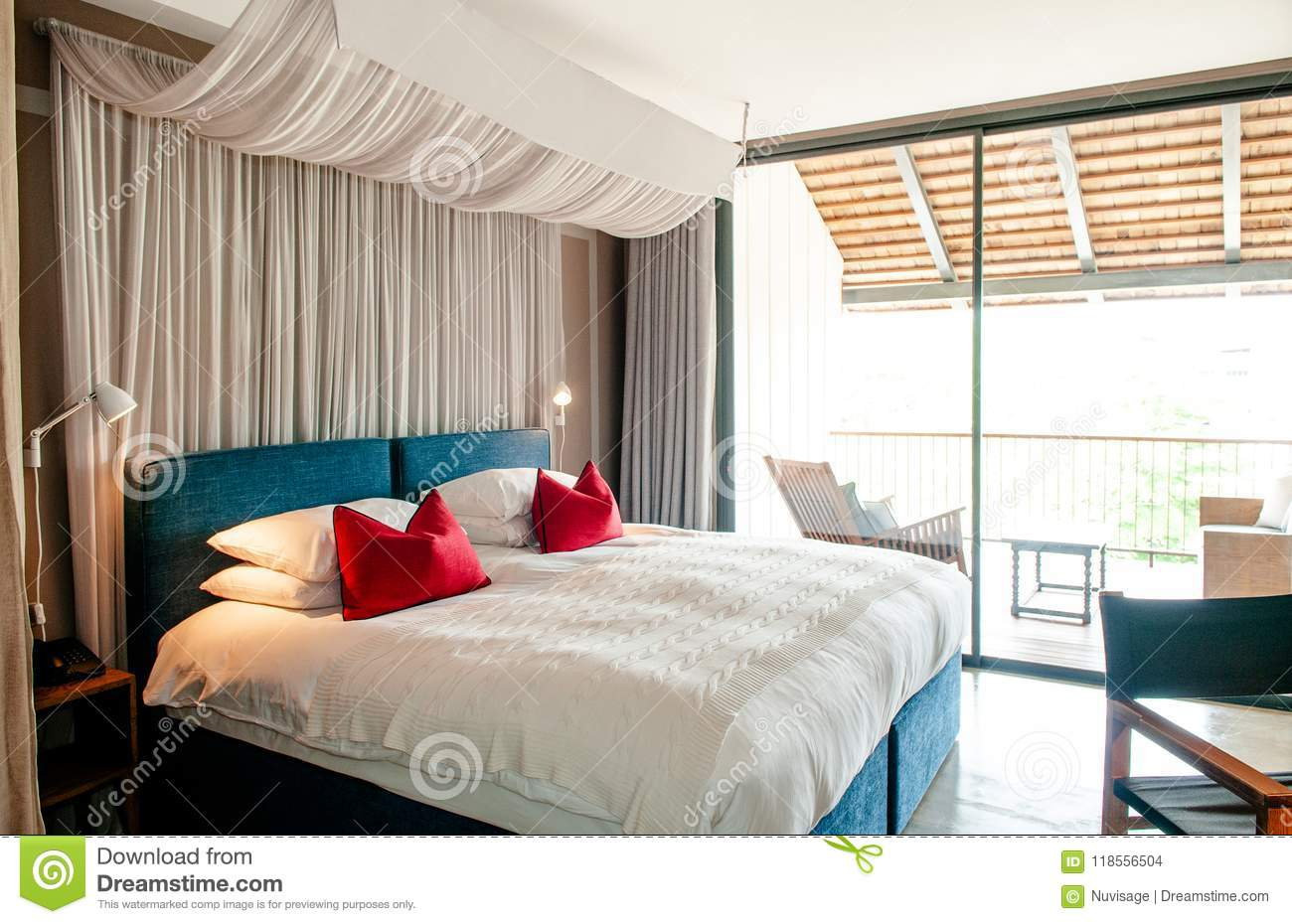 Colonial Style Bedroom Wooden Bed With Curtain Pillows And Lamp Editorial Stock Image Image Of Domestic Architecture 118556504