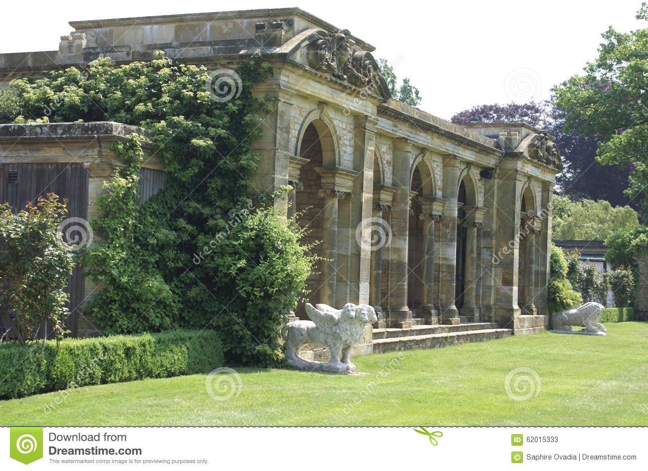 Colonnade and lion statues at Hever castle Italian garden in England