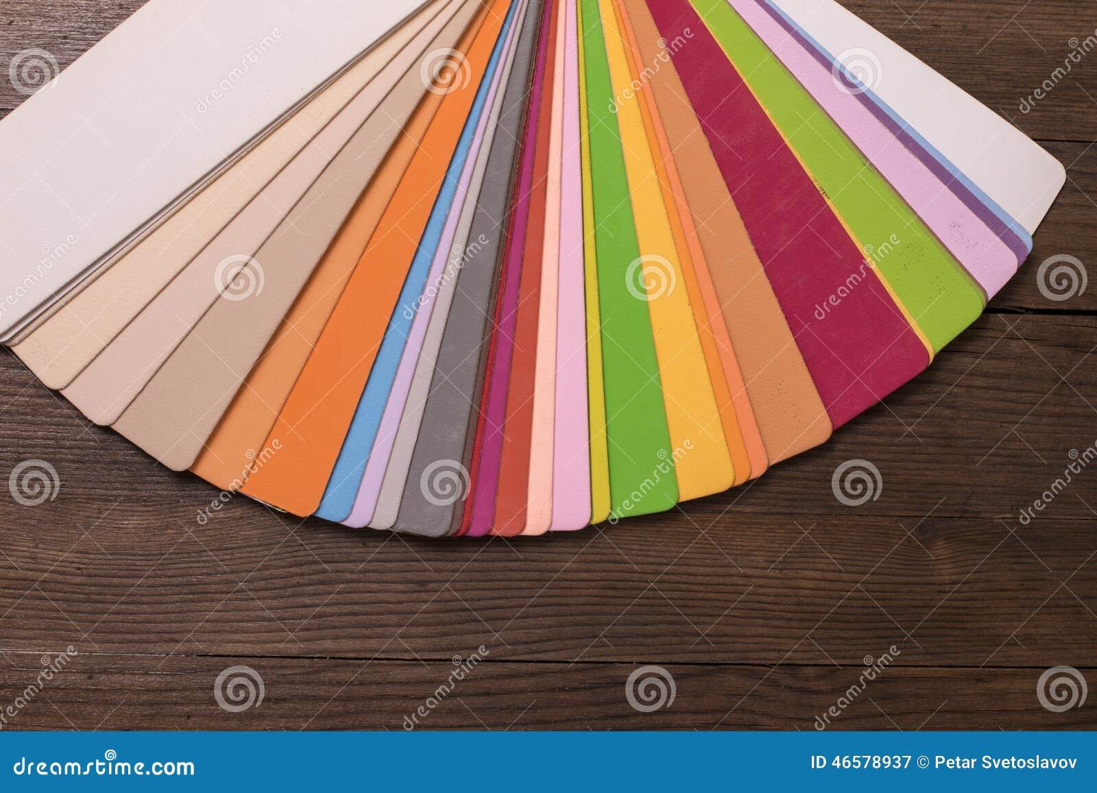 color catalogue on wooden desk stock photo image 46578937. Black Bedroom Furniture Sets. Home Design Ideas