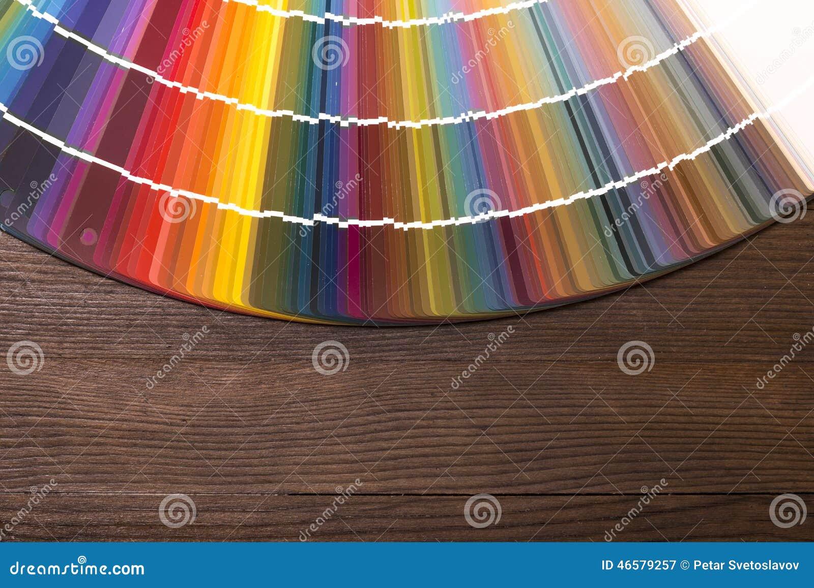 color catalogue on wooden desk stock photo image 46579257. Black Bedroom Furniture Sets. Home Design Ideas