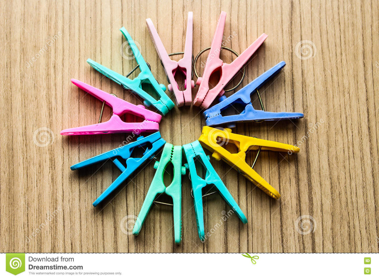 The Color Clothespin Drop To The Floor In A Circle Stock Photo