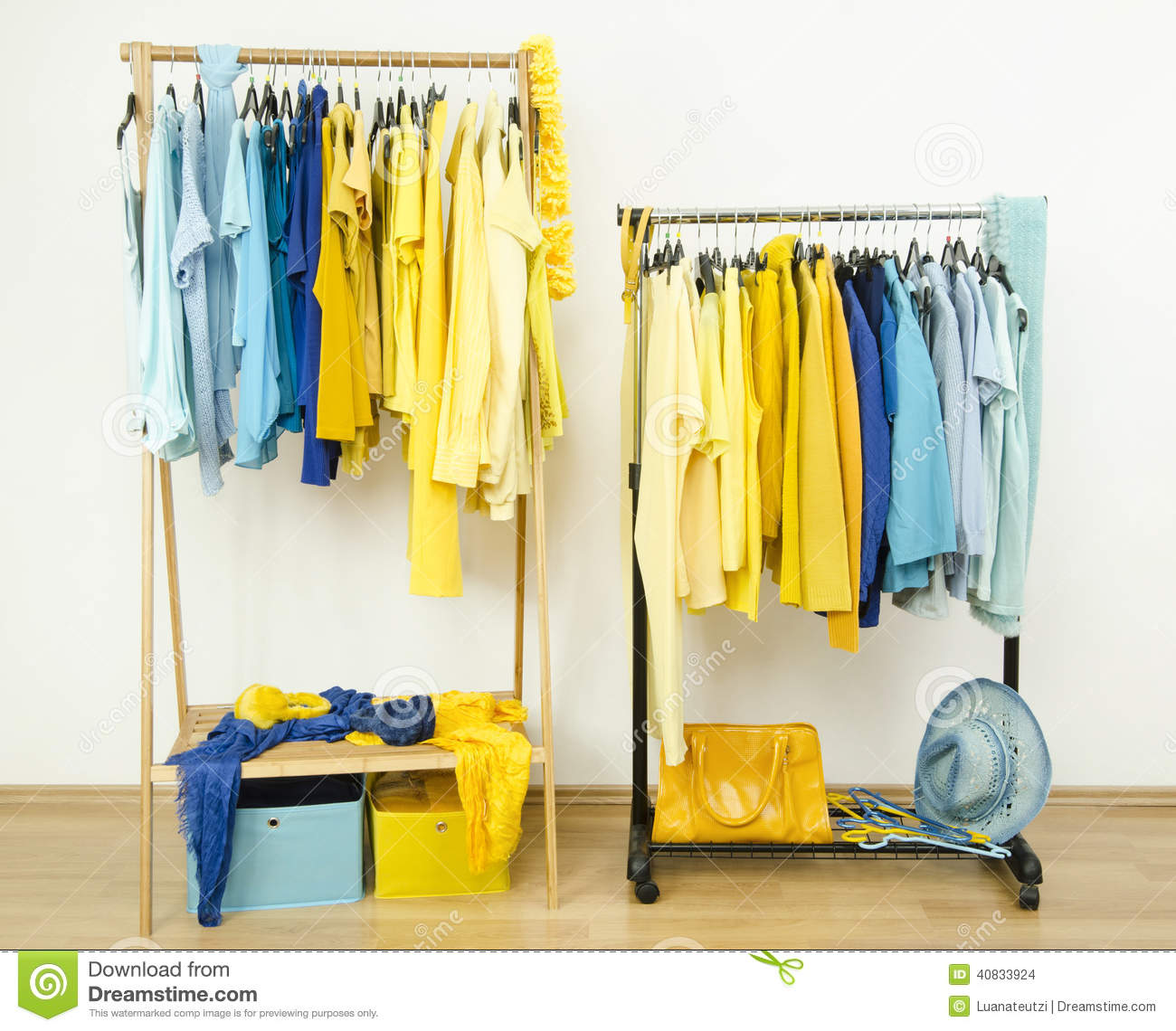 Color Coordinated Yellow And Blue Clothes On Hangers