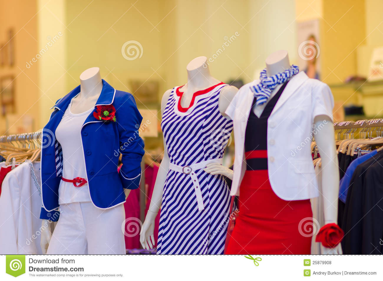 6a508c35f5fd At front of shop. Color dresses and suits on mannequins in mall. Color  dresses and suits on mannequins in