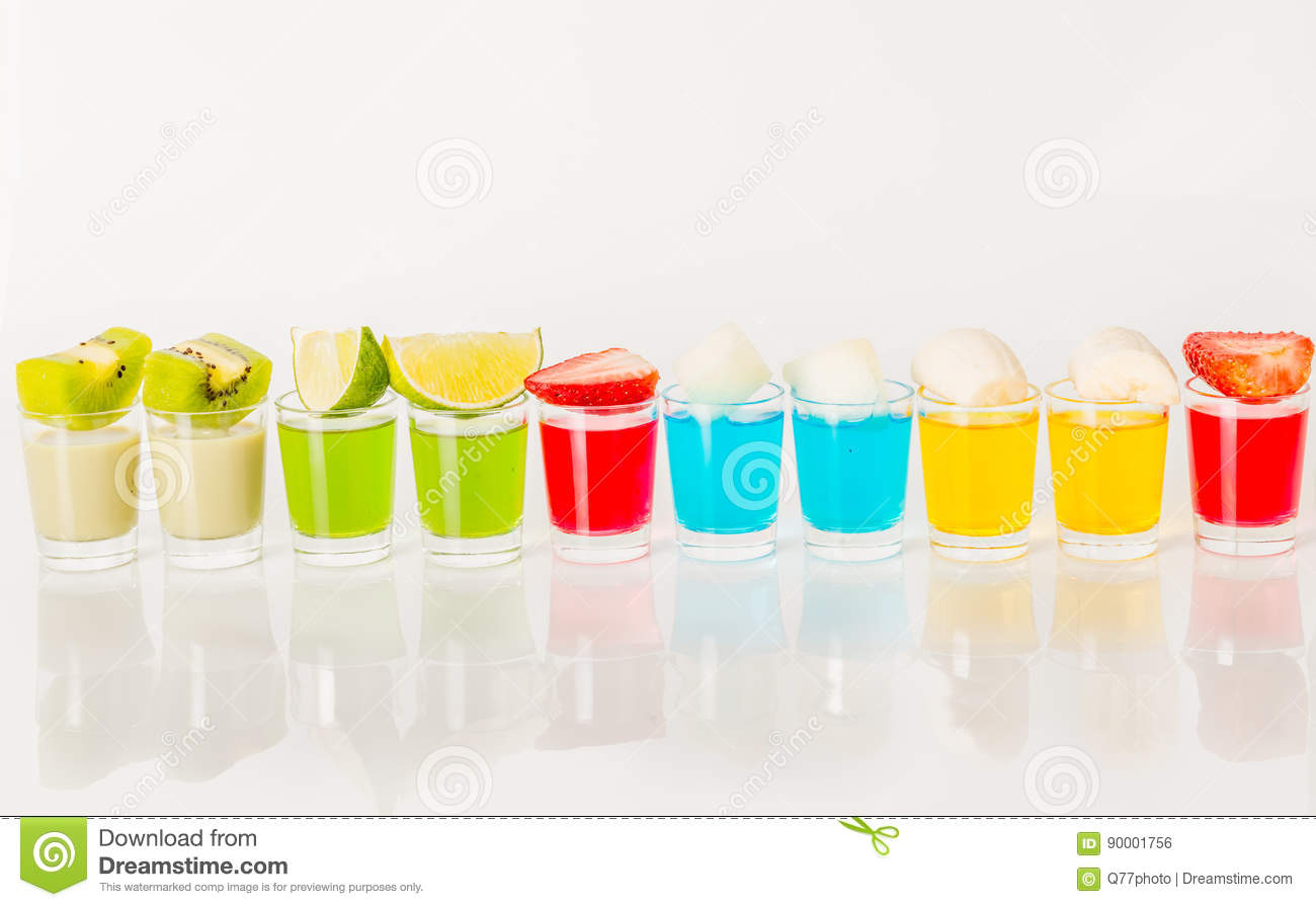 Color drinks in shot glass, blue, green, red, yellow and creamy