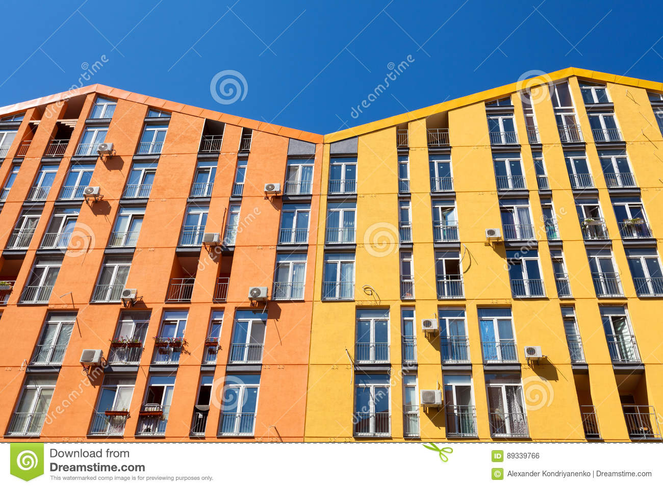 Color facade of a house with lot of air condition units.