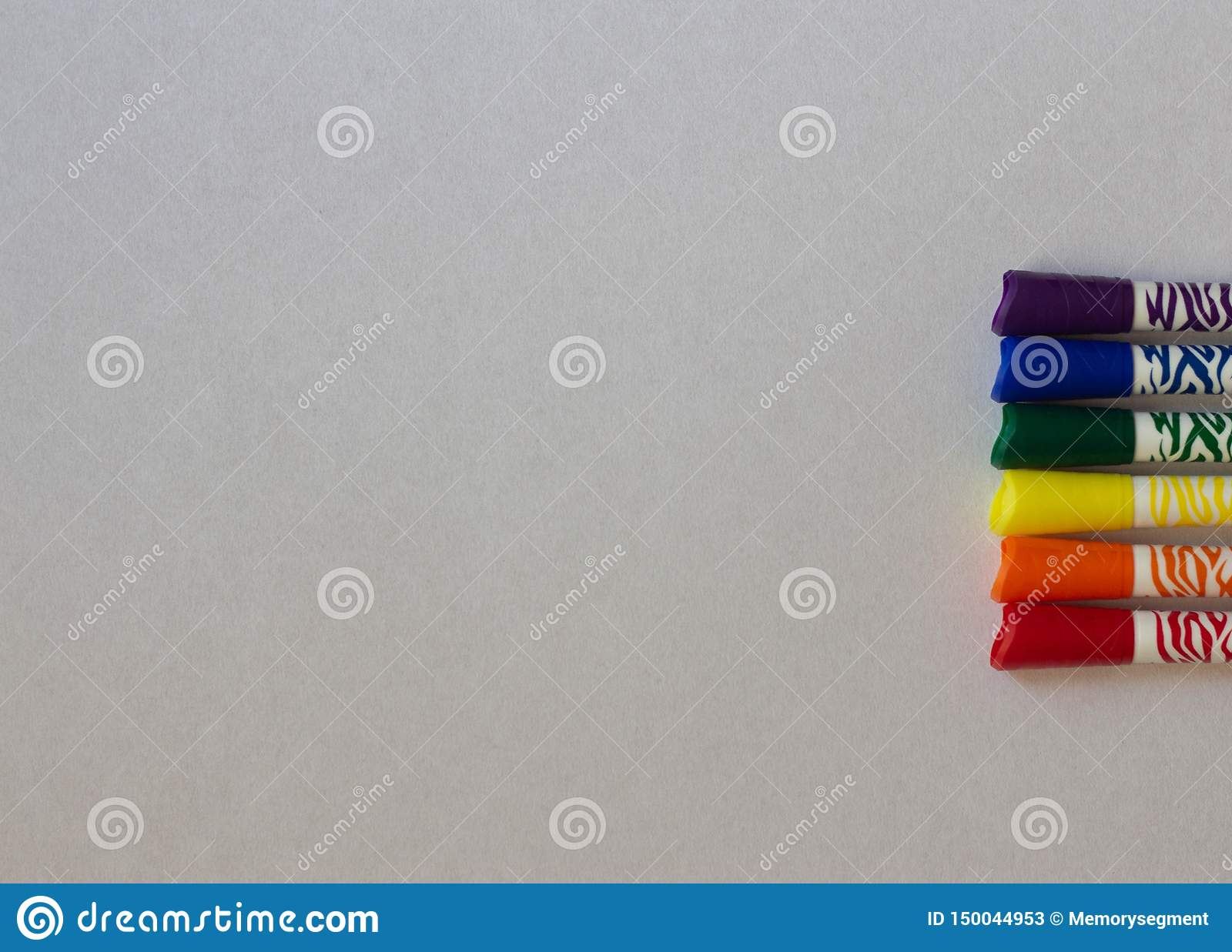 Colored LGBT markers on a white background close-up