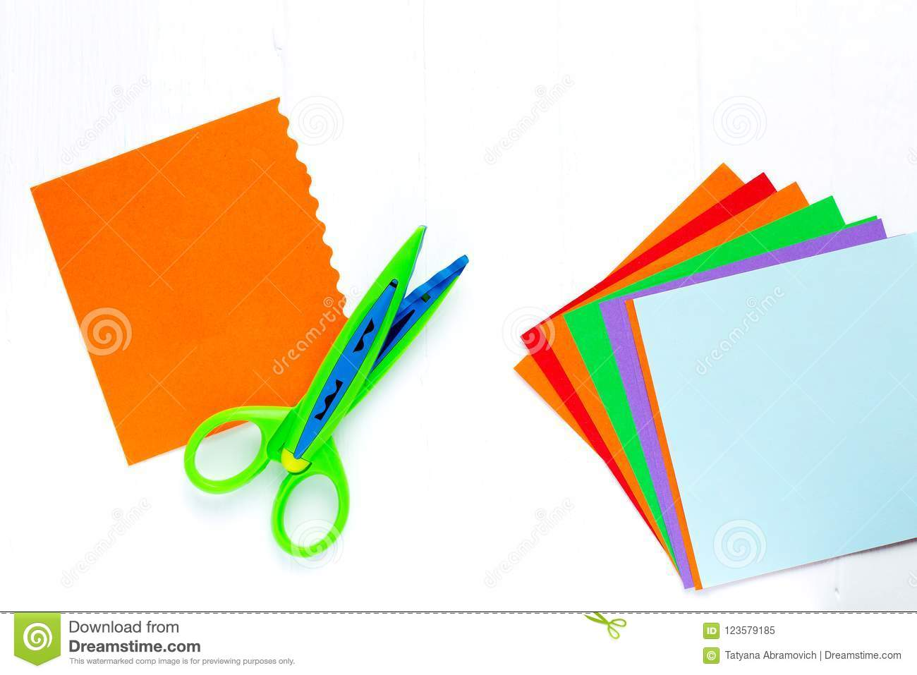 Color Paper For Origami Is A Fan Scissors With A Wavy Edge On