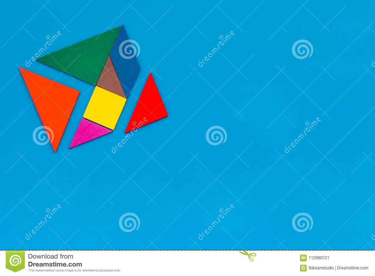 Color paper pieces for business puzzle blue table background top view space for text
