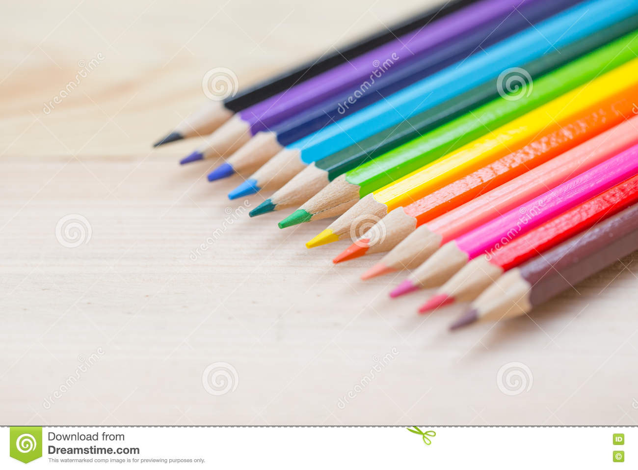 Download Color Pencil On Wood Table Background Stock Photo
