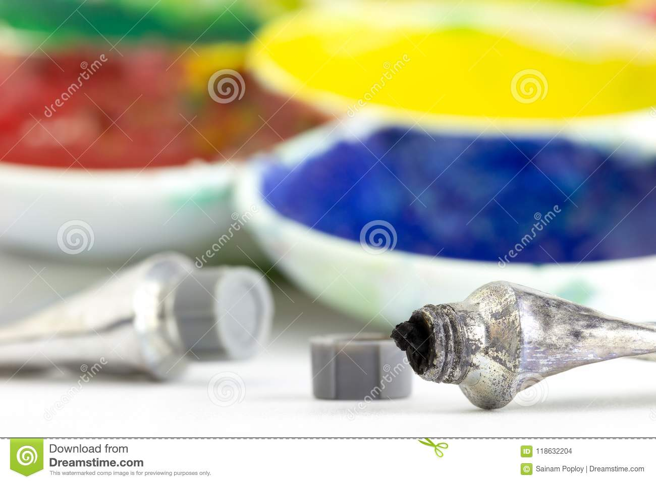 Color tubes and palettes placed on white background.